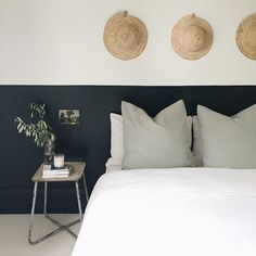 Bedroom with half a wall in the darkest charcoal shade!