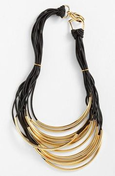 Dress up a casual tee with this metallic strand necklace.
