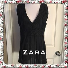Zara Top  Adorable black Zara basic top in perfect condition! Sleeveless tie back, zipper on the left side for easy slip on. Tag reads size XL but fits more like size M. 78% Cotton 22% Nylon Zara Tops Blouses