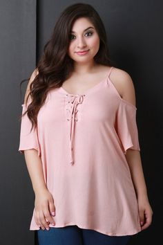 This plus size top features v-neck with lace-up detail, spaghetti straps, cold shoulders, short sleeves, and relaxed fit. Available in Pink, Black, and Ivory Accessories sold separately. 100% Rayon. M