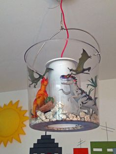 Apparently this bucket style light is from Ikea. Making it into a cool model terrarium is a great idea.