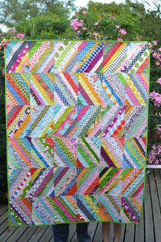 """https://flic.kr/p/ew4FJz   scrappy string quilt   stats: measures 60 x 46 foundation pieced on paper FMQ'd in a small, all-over loopy swirl on my Juki made of all my string scraps with no attention to color or pattern or anything, except """"does it cover the paper?"""" i started this quilt for the festival of strings at stitchedincolor.com and am happy to say i finished it way ahead schedule and am so happy all of my string scraps found a home."""