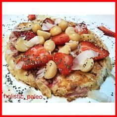 Strawberry pancake topped with fresh strawberries, raw macadamia nuts, coconut flakes, chia seeds and organic maple syrup. There were fresh strawberries and flaked almonds in this paleo, gluten, dairy and sugar free pancake also. #breakfast #pancake #glut
