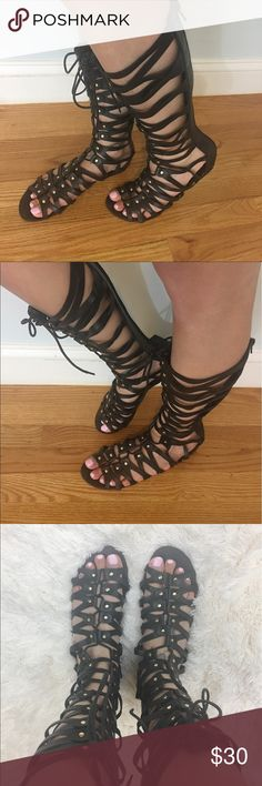 """Just Fab Black Gladiator Sandals Excellent, used condition. Super cute tie going down the middle with gold studs and zipper in back. Sole is 10"""". Size 8.5. JustFab Shoes Sandals"""