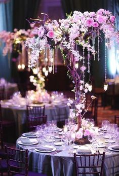 Whimsical Wedding Centerpieces Designed By Raining Roses Orlando I Like That It Doesnt Block Views Stuff Hangs Would Do Purple Color Scheme