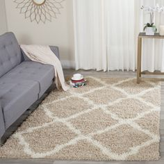 Shop for Safavieh Dallas Shag Beige/ Ivory Rug (10' x 14'). Get free shipping at Overstock.com - Your Online Home Decor Outlet Store! Get 5% in rewards with Club O!