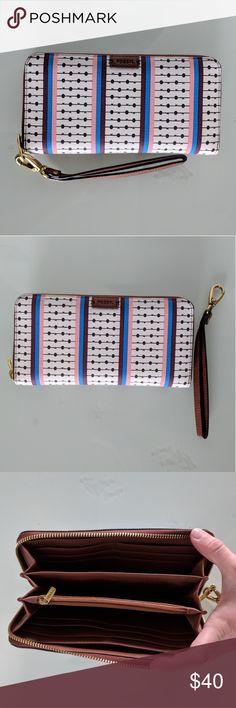 Fossil Emma RFID clutch wallet/wristlet Gorgeous large zip wallet clutch that is in EUC with no stains and very minimal wear, looks like-new. The outer is PVC and inner is polyester. It has a space for a phone, up to an iPhone 7 plus, and has 12 Credit Card Slots. It does have the RFID lining as well to keep your credit cards safe. Stock photos at the end for clarification. Still in store, just want a new wallet  instead. Bundle 2 more to save 10% off your entire order! Fossil Bags Wallets