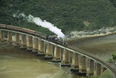 """""""South Africa, Western Cape, Wilderness National Park, Tootsie Steam Train On Bridge At Dolphin Point Travelling Between George And Knysna """" Old Steam Train, Railroad Bridge, Knysna, Amazing Pics, Train Travel, Poster Size Prints, Photo Mugs, Photo Gifts, Wilderness"""