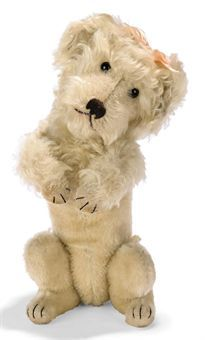 STEIFF LARGE HEAD-TURNING POODLE, white mohair, black glass eyes, black stitching, tail-operated head turning mechanism, squeaker and FF button, circa 1932.