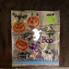 Easy DIY window cling saver.  Cut plastic bag in half, place clings on one side then cover with other half of bag.