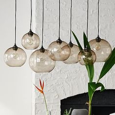 Obsessed with globe pendant chandeliers for the dining room. Glass Orb Chandelier - Luster #westelm