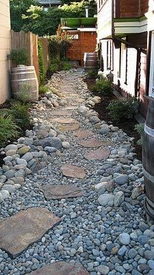 Stone pathway for side of house to help with drainage... this path needs something green and low maintenance to soften it, like hostas or ferns