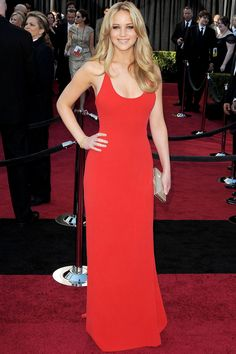 Jennifer Lawrence at the 2011 Oscars - the year she was nominated in the Best Actress category - wearing a Calvin Klein Collection custom-made red dress.