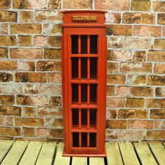 85cm Large Red Wooden Retro Red Telephone Box CD Rack Cabinet  Holds about 90 CDs  Amazon link: https://www.amazon.co.uk/Large-Wooden-Retro-Telephone-Cabinet/dp/B00D5UO0F8/ref=sr_1_3?ie=UTF8&qid=1468680881&sr=8-3&keywords=CD+rack+with+door