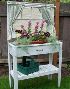 super cute potting bench with window and curtains!