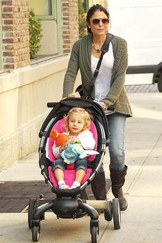 Battery-powered 4Moms Origami stroller that folds at a touch of a button and charges a cell phone. Hello!