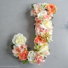 DIY Floral Monogram Letter for a Blooming First Birthday Bash, inspired by spring flowers in pink, blush, and white. DIY party ideas for a woodland floral-themed celebration, spring fling, or botanical garden party!