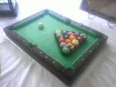 Pool Table - Chocolate sheet cake with Madagascar Vanilla cupcakes.