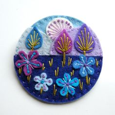 Treescape felt brooch with freeform embroidery by designedbyjane, £15.00  I really want to master the french knot...so pretty!