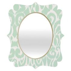 """Ikat wall mirror by Khristian A. Howell for DENY Designs.   Product: MirrorConstruction Material: Engineered wood and aluminumColor: MutliFeatures:  Original design by Khristian A Howell for DENY DesignsGlossy aluminum face     Dimensions:   Small: 19.5"""" H x 14.5"""" W   Medium: 29.2"""" x 21.7""""  Large: 36"""" H x 30"""" W     Cleaning and Care: Spot clean with window cleaner"""