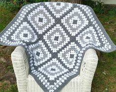 This baby blanket in contemporary colors makes a perfect gift. Small enough to pack in a diaper bag or drape over a carrier. Great for naps away from home. Made of worsted weight acrylic yarn that is machine washable and dryable. Measures 35L x 35W.