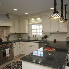 cabinet/granite combination...cream cabinets. black with silver and grey for granite