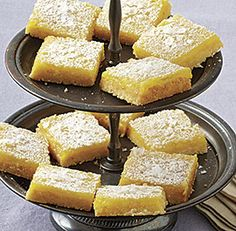 A fresh look at lemon bars with secret ingredients. In the lemon curd, use concentrated chamomile tea, which adds a floral note that really rounds out the lemon. Cornmeal gives the crust an ever-so-slightly crunchy texture to balance out the softness of the lemon curd and finish the bars with a little sea salt, which makes all the flavours pop.