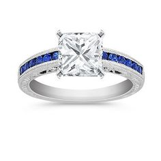 I absolutely LOVE the blue around the band! Vintage Sapphire Engagement Ring with Channel Setting