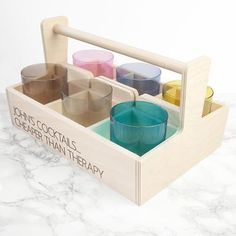 This fun set of vibrant coloured cocktail tumbler glasses is the perfect gift for a lover all cocktails. The glasses come in a fabulously adorable wooden trug which is engraved with up to two lines of text. The trug is fantastic for both displaying the set when not used and serving the delicious cocktails without risk of spilling. The shot glasses come in 6 different colours: Turquoise, Baby Pink, Grey, Beige, Blue, Green.