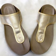 NWOT Donald J. Pliner Merie Flat Sandal Who says casual can't be glam! Add a pop of gold to your on-the-go look with these slide on metallic sandals. Comfortable, stylish, effortless! No flaws, price removed, never worn. Donald J. Pliner Shoes Sandals