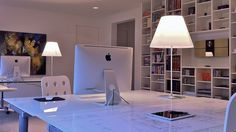 A great home office/studio, with iMacs, iPad, abstract art, good light and a vintage bang & olufsen Beocenter music system.