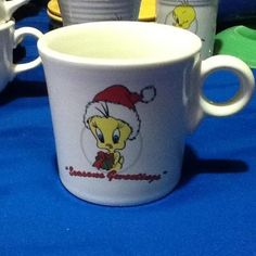 "Fiesta® LOONEY TUNES Tweety Bird Christmas Mug inscribed with ""SEASON'S GWEETINGS"". Made exclusively for Warner Bros by Homer Laughlin China Company 