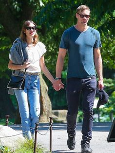 Alexa Chung on a date with Alexander Skarsgard wearing an off-the-shoulder top, jeans, and high-waisted jeans