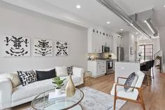 Construction complete, first owners move in to James Place Lofts in Brush Park Bedroom Loft, Two Bedroom, Construction City, Two Story Windows, Ice Houses, Luxury Condo, Built In Cabinets, New Builds, Smart Home
