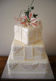 Three tier lace panel lily wedding cake