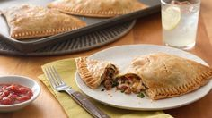 A flaky pie crust encloses flavorful chorizo, spinach, cheese and salsa. Your taste buds will thank you for making this  empanada!