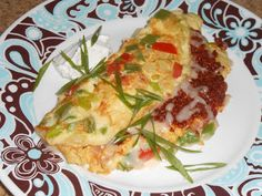 Chef JD's Southwestern CuisineBeef Chorizo and Queso Manchego Spanish Omelette:      This recipe yields 1 hearty omelette.      For some odd reason I had no black olives when I made the omelette for the photo example.  This reminded me of way back when I was doing some breakfast cooking in diners.  Many customers used to order Spanish Omelets with no black olives.        Step 1:  Heat a sauté pan over medium/medium low heat.      Add 5 ounces of Mexican style uncased beef chorizo sausage…
