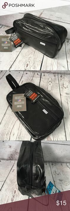 """NWT Men's black leather travel / shave kit bag New with tags Men's black leather travel / shaving bag. (no price on tags) •Genuine lightweight leather with vintage patch work embossed pattern •Zip top closure •Front zipper pocket •Side handle for easy carrying. Dimensions: 11""""x7""""x4"""" Embassy Bags Luggage & Travel Bags"""