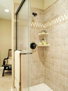Buy Less Tile Stretch your remodeling budget by tiling only the shower and/or bath area walls. If it's within your budget, tile halfway up the wall, add a border design, and paint above the area. Bathroom Renos, Bathroom Renovations, Bathroom Ideas, Bathroom Updates, Bathroom Showers, Downstairs Bathroom, Bathroom Faucets, Modern Bathroom, Shower Remodel