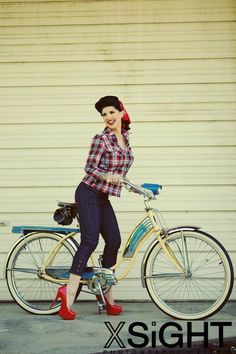 love the outfit but red flats would have been better...dont think iver ever seen anyone riding a bike in 5 in heels...lol