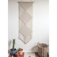 This macrame wall hanging is handmade using 100% cotton cord (4.5mm) in natural ecru with a bamboo supporting rod.  Dimensions - Bamboo Width: 55cm / 21.75 Weaving Width: 51cm / 20.25 Length: 150cm / 59  This design can also be made in white, charcoal or black - please send me a message to check availability of these colours before placing your order.  Alternatively, if you are interested in a variation of this design or would like to have something custom made please feel free to contact…