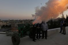July 10, 2013. A cannon fires a ceremonial shot just outside Jerusalem's Old City, to mark the end of Muslims' daily fast during the holy month of Ramadan.