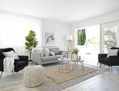 [LIVING ROOM REVEAL ✌] It has the most calming feel this room... Could sit in it all day! #ifididnthave4boys4dogsandahusband #nestinginnorthmeadrenofour #threebirdsstyling #threebirdsreveal | rugs, Fig, ottoman @hamptons_at_home_sydney | Retro Armchairs, timber coffee table @ozdesignfurniture | marble coffee table @westelmaus | horse print @oliveetoriel