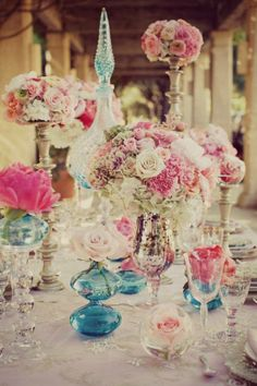 "When it comes to a ""vintage"" style wedding, this decor is absolute perfection. Soft colored flowers mixed with blue and metallic glassware is the perfect combination. www.celebrationsbykat.com"