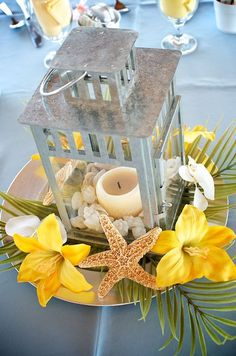 Lemon yellow beach wedding centerpiece. A wedding centerpiece ideal for the beach and summer breeze.