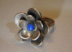 #Handmade Artists         #ring                     #Sterling #silver #flower #ring #with #blue #lapis #lazuli #stone #Handmade #Artists' #Shop             Sterling silver flower ring with blue lapis lazuli stone on Handmade Artists' Shop                                                http://www.seapai.com/product.aspx?PID=76193