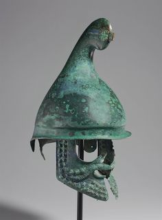 A GREEK BRONZE PHRYGIAN HELMET LATE CLASSICAL TO EARLY HELLENISTIC PERIOD, CIRCA 350-300 B.C.  | Christie's