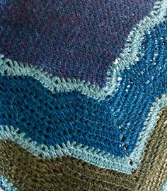 Shoal is a gorgeous crocheted variation on traditional Shetland Hap shawls which have a plain central panel and gracefully waving lace…