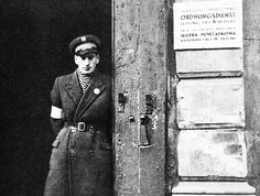 The entrance to the Jewish Police Station in the precinct of the Warsaw ghetto. The Jewish police and the Judenrat were established by the Nazis and were charged with enforcing the orders of the German authorities concerning the Jewish population. Jewish Ghetto, Warsaw Ghetto, Tuskegee Airmen, University Of South Florida, Police Uniforms, Police Station, Persecution, Historical Pictures, Vintage Photographs