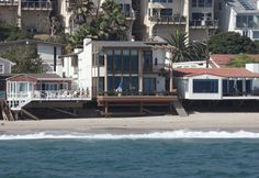 Ryan O'Neal (Malibu, CA) Ryan O'Neal's beachfront deck is loaded with toys - including a soft top longboard.